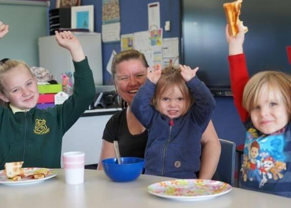 Hayley and her children enjoying Foodbanks School Breakfast program