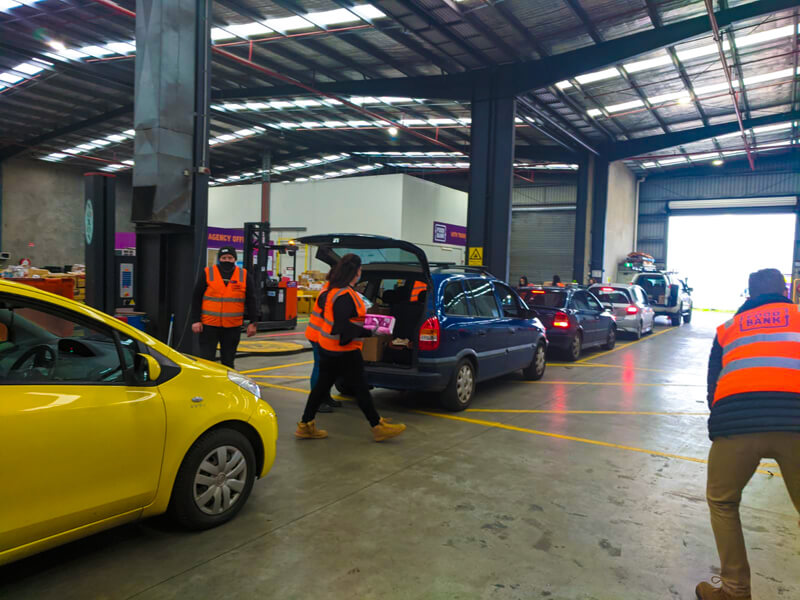 Line up of cars receiving hampers at the Foodbank Victoria drive-thru